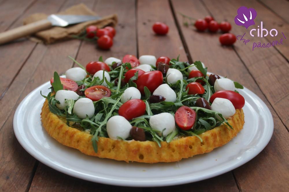 Crostata morbida salata con rucola e pomodorini